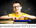 Cheerful boy with bunch of books 43715299