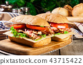 Ciabatta sandwich with smoked bacon and other 43715422