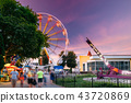 Attraction Ferris Wheel On Summer Evening In City Amusement Park 43720869