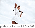 Woman posing on tennis court 43722249