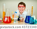 Cute boy is making science experiments in a laboratory 43723340