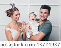 girl in the hands of the Prince and Princess 43724937