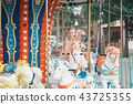 girl riding in the Park on a toy horse on carousel 43725355
