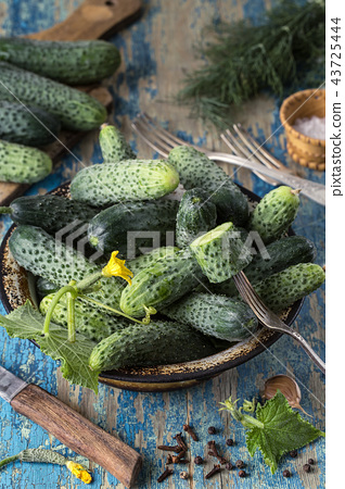 Fresh cucumbers in a bowl on vintage  table 43725444