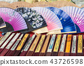 Traditional handicraft chinese fans at market 43726598