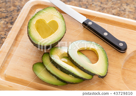 Fresh Cut Avocado With Heart Shaped Pit On Wood  43729810