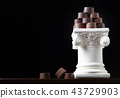 Stack of Fine Artisan Chocolates On Fancy Pillar 43729903