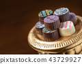 Fancy Display of Colorful Fine Artisan Chocolates 43729927