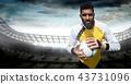 Goalkeeper holding football in stadium 43731096