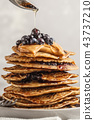 Stack vegan blueberry pancakes with peanut butter 43737210