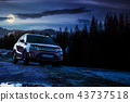orange 4wd suv parked in mountain at night 43737518