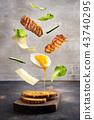 Breakfast sandwich in levitation above cutting board 43740295