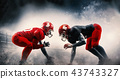American football players in action play in professional sport stadium 43743327