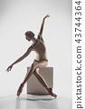 Ballerina. Young graceful female ballet dancer dancing at studio. Beauty of classic ballet. 43744364