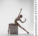 Ballerina. Young graceful female ballet dancer dancing at studio. Beauty of classic ballet. 43744377