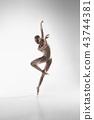 Ballerina. Young graceful female ballet dancer dancing at studio. Beauty of classic ballet. 43744381
