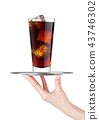 Hand holds tray with cola soda drink with ice 43746302