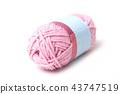 closeseup of pink wool bobin on white background 43747519