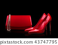 Red bag and red shoes on a black background 43747795