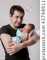 man and child in a black and blue 43748911
