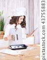 Light wooden background. Cooking bun. Baby girl 43755883