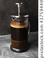Coffee in french press on dark background 43759449