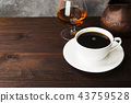 Coffee in white cup with cognac and clay cezve 43759528