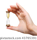 Close up of woman hand holding hourglass 43765391