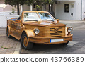 Large wooden cabriolet on the street of Budva 43766389