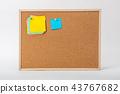 Blank sticky note on cork board 43767682
