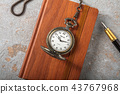 Diary with fountain pen and vintage pocket watch 43767968