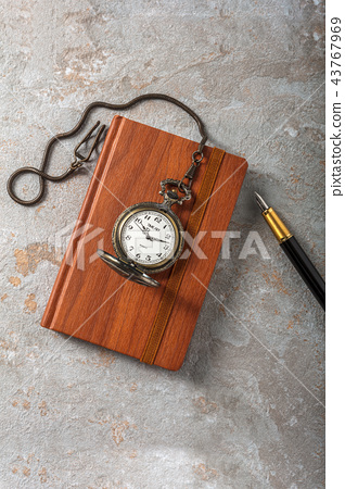 Diary with fountain pen and vintage pocket watch 43767969