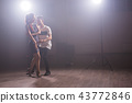 Young couple dancing latin dance Bachata, merengue, salsa. Two elegance pose in dance class 43772846