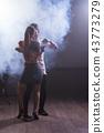 Young couple dancing social danse kizomba or bachata or semba or taraxia in dancing class background 43773279