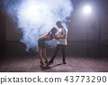 Young couple dancing latin dance Bachata, merengue, salsa. Two elegance pose in dance class 43773290