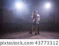 Young couple dancing social danse kizomba or bachata or semba or taraxia in dancing class background 43773312