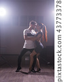 Young couple dancing latin dance Bachata, merengue, salsa. Two elegance pose in dance class 43773378