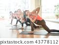 Asian woman doing yoga in yoga studio 43778112