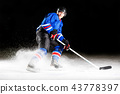 Hockey player turning around skating on ice 43778397