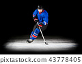 Young hockey player with stick isolated on black 43778405
