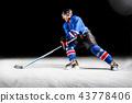 Hockey player turning around skating on ice 43778406