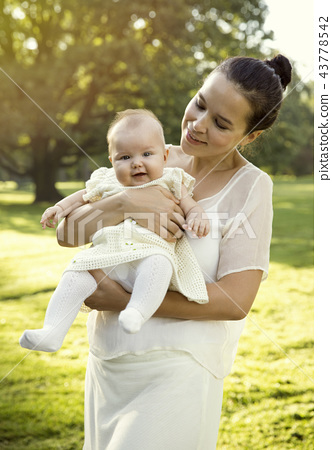 Mother holding baby girl on her hands 43778542