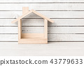 Wood Home Shaped on white wood over white wood bac 43779633