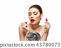 girl applying red lipstick isolated on white 43780073