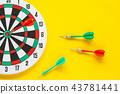 Dart arrow on target dartboard ,Business success 43781441