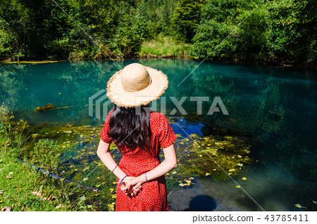 Girl enjoying day outdoors at a natural water well 43785411