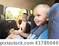 Boy buckled into car seat 43786049