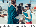 Happy woman speaking with unshaven man outdoor 43787977