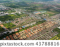 Aerial view of city through airplane window 43788816