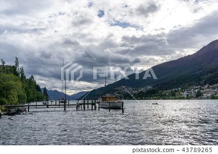 lake wakatipu and a small dock 43789265